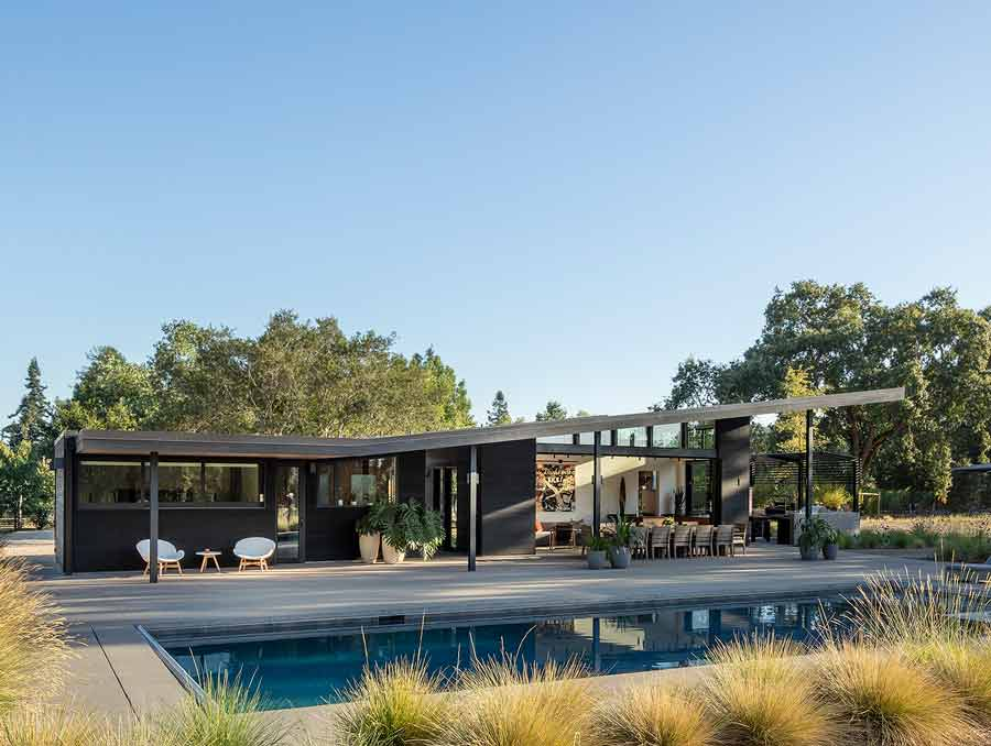 Modern home showing pool, patio